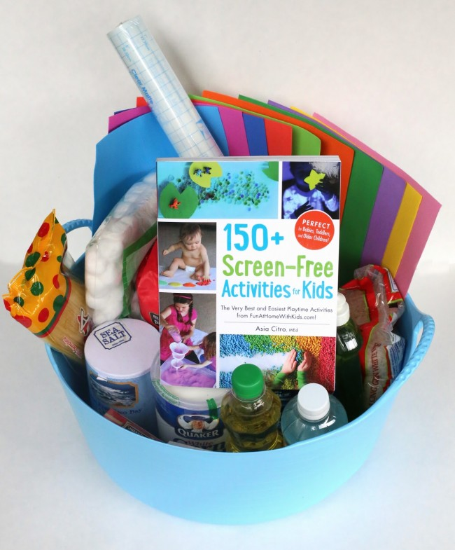 Hatching Frogs with 150 Screen-Free Activities for Kids: reading the book, then building the small world in a sensory bin