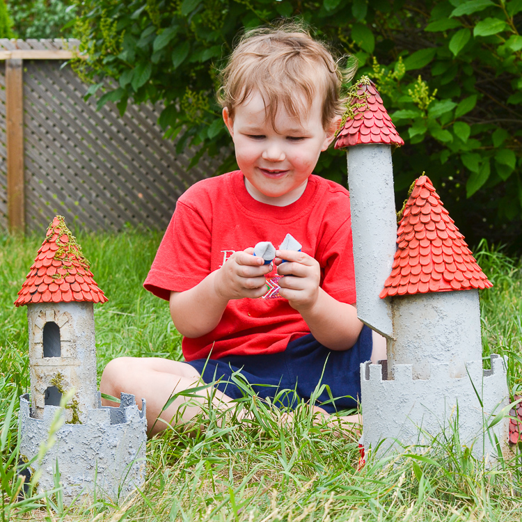 DIY Make a Cardboard Castle from Recyclables: Playing with the castle.