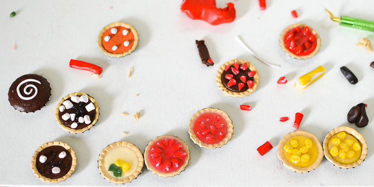 Make Miniature Pies with Kids: Glaze the tops of the fruit tarts.